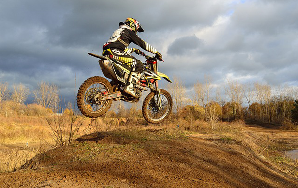 Picture of a dirt biker jumping a hill